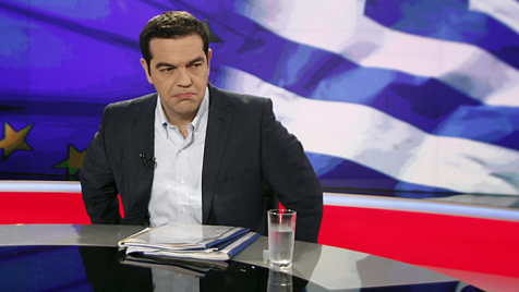 W wystąpieniu telewizyjnym Cipras nawołuje o zagłosowanie przeciwko propozycji kredytodawców Grecji (fot.PAP/EPA/ALEXANDROS VLACHOS)