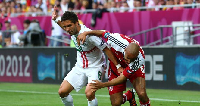 Joao Moutinho w starciu z Simonem Poulsenem (fot. Getty Images)