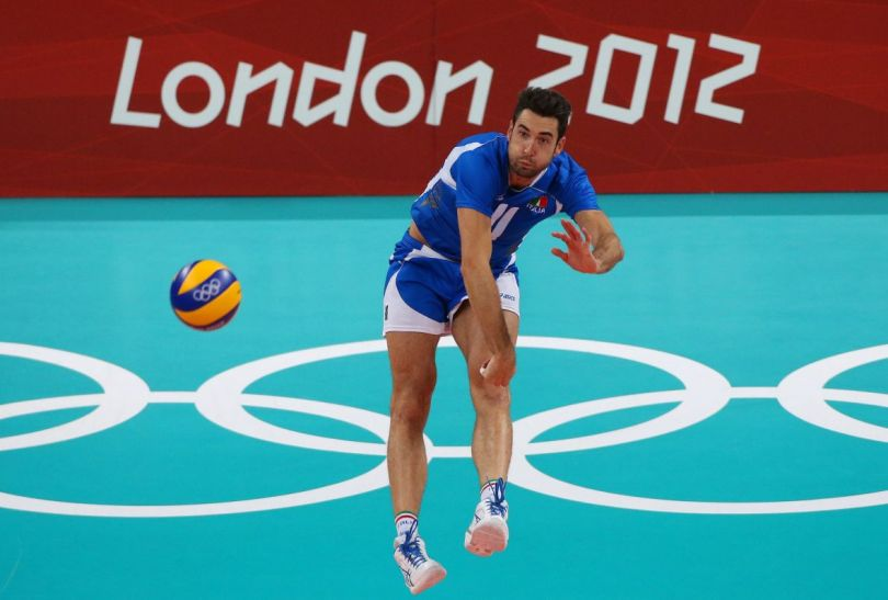 Cristian Savani podczas zagrywki (fot.PAP/EPA)