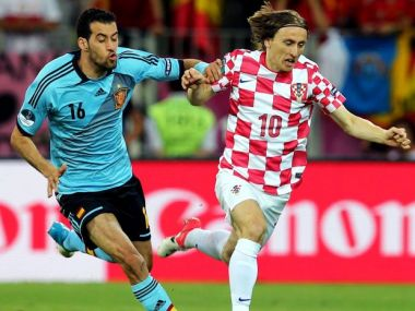 Sergio Busquets (L) i Luka Modrić (fot Getty Images)