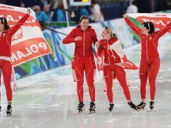 Katarzyna Bachleda Curuś, Luiza Złotkowska i Katarzyna Woźniak zdobyły brąz w biegu drużynowym (fot. Getty Images)
