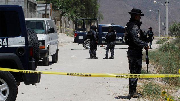 Ekshumacje zajmą minimum miesiąc (fot. REUTERS/Jorge Duenes)