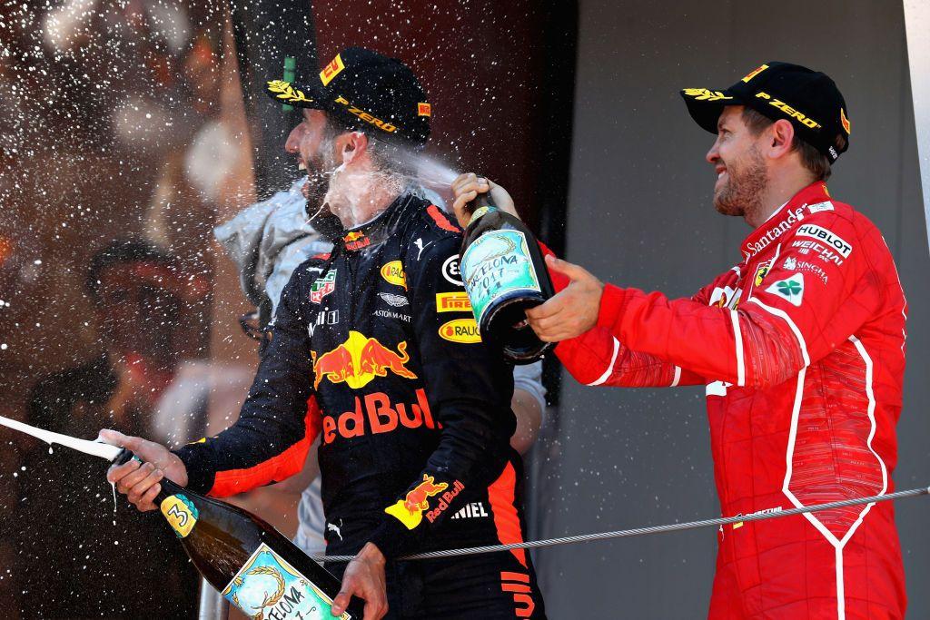Zdobywcy drugiego i trzeciego miejsca Sebastian Vettel i Daniel Ricciardo (fot. Mark Thompson/Getty Images)