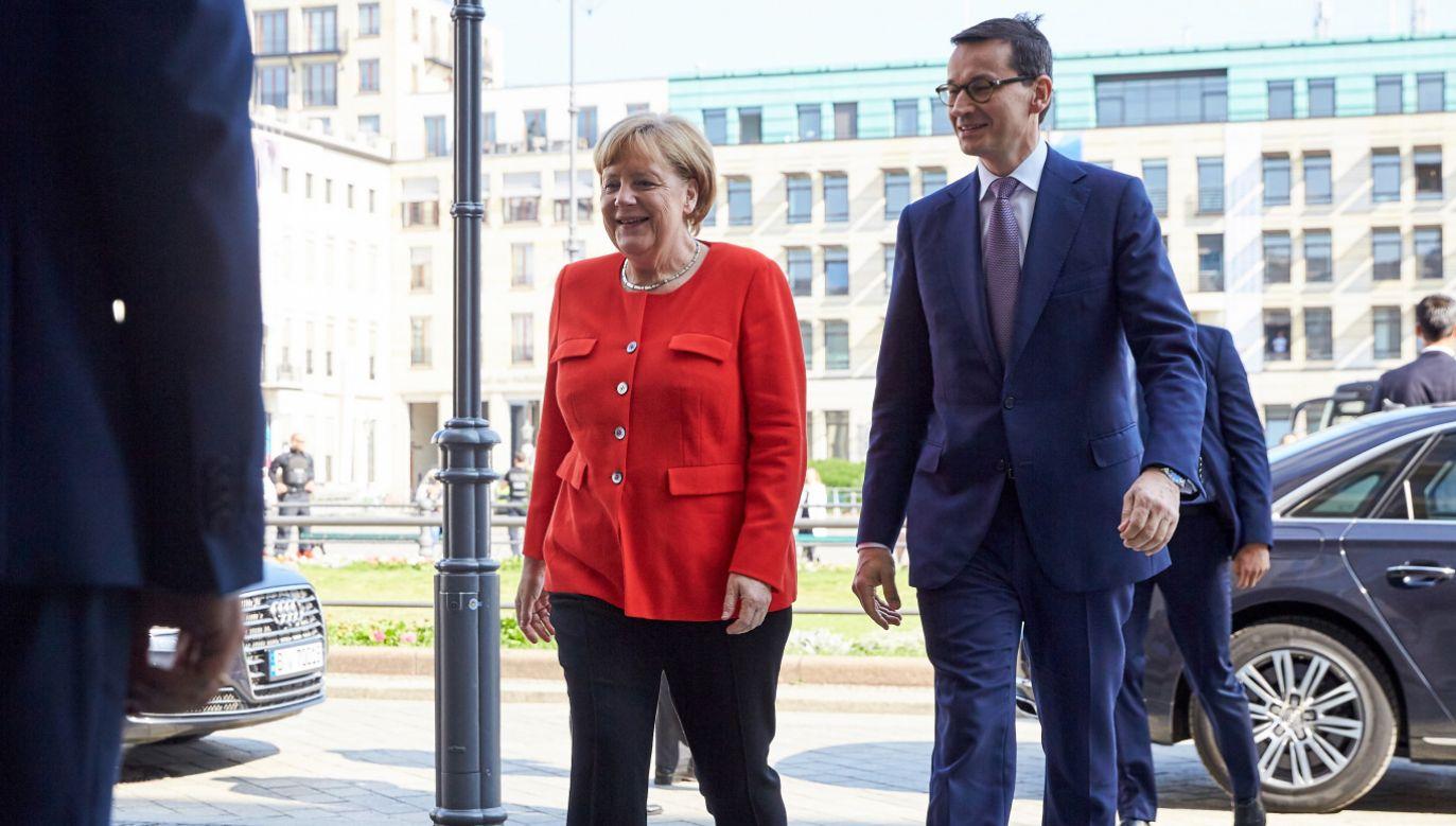 Premier RP Mateusz Morawiecki i kanclerz Niemiec Angela Merkel (fot. PAP/EPA/HAYOUNG JEON)