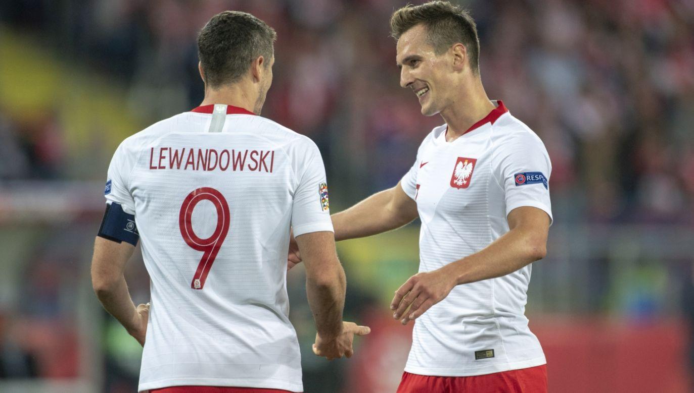 Robert Lewandowski (L) i Arkadiusz Milik (P) (fot. Getty Images)