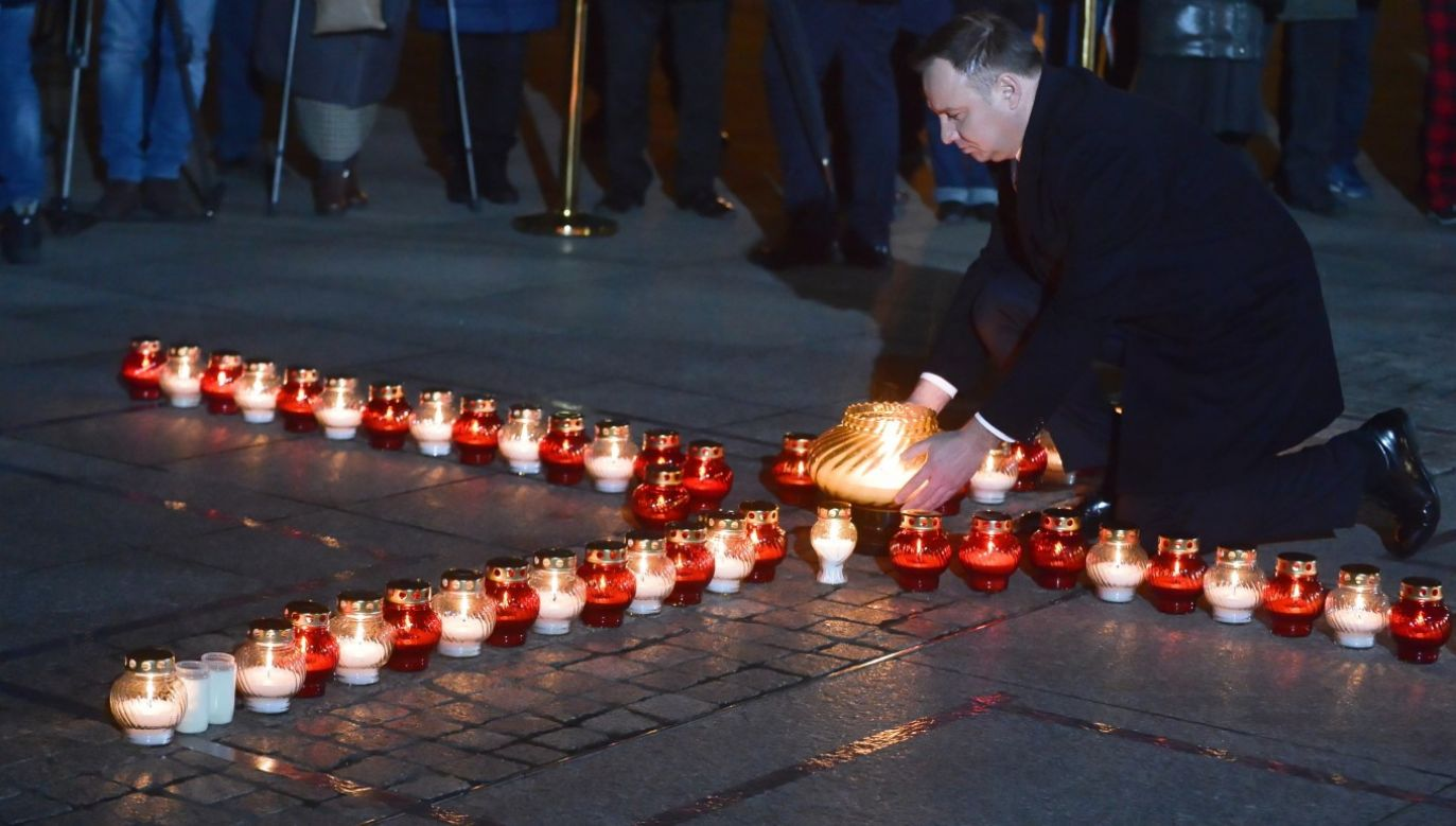 Poland's president stressed that remnants of the evil spawned by the communist regime in Poland had to be