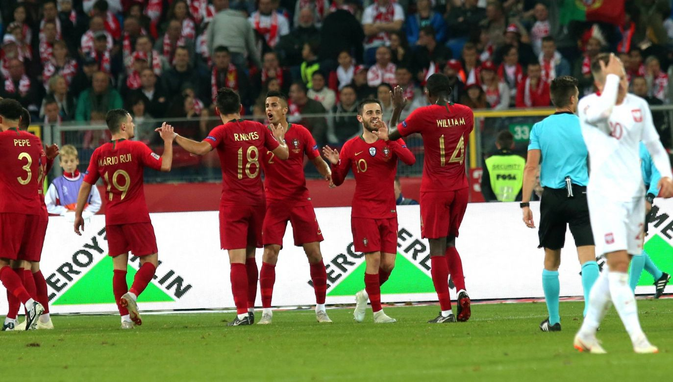 Portuguese players celebrate after scoring the second goal. Photo: PAP/Andrzej Grygiel
