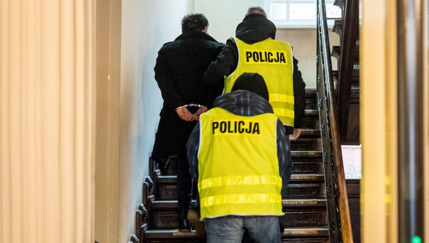 Matthew L. detained by the police. Photo: PAP/Tytus Żmijewski