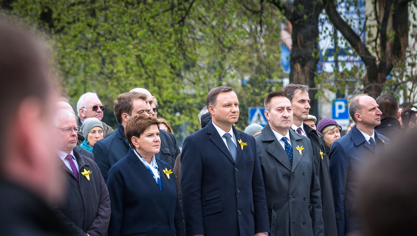Top Polish officials attend the annual commemorations, including Polish President Andrzej Duda (C) and then-PM Beata Szydło (2L). Photo: Shutterstock/Darek Warczakoski