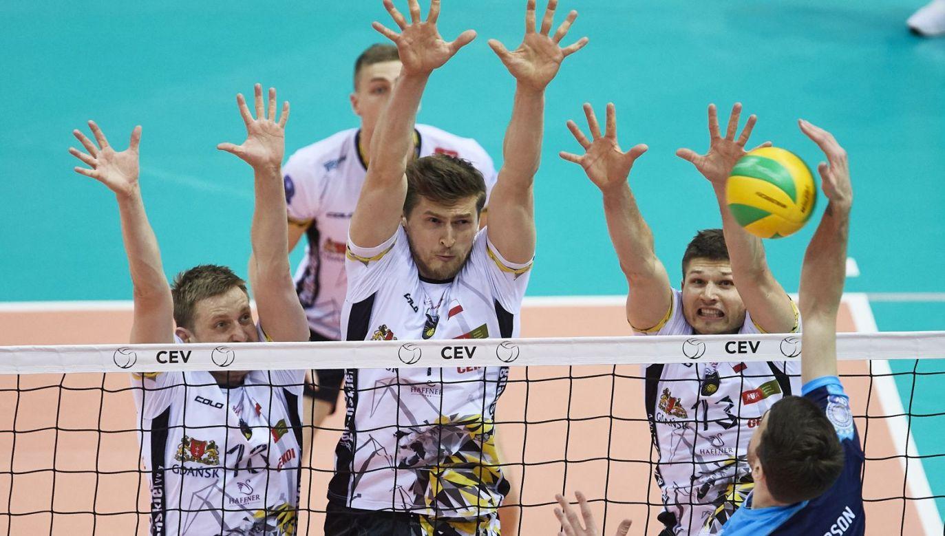 Michał Kozłowski, Piotr Nowakowski i Ruben Schott blokują Johna Matthew Andresona (fot. PAP)
