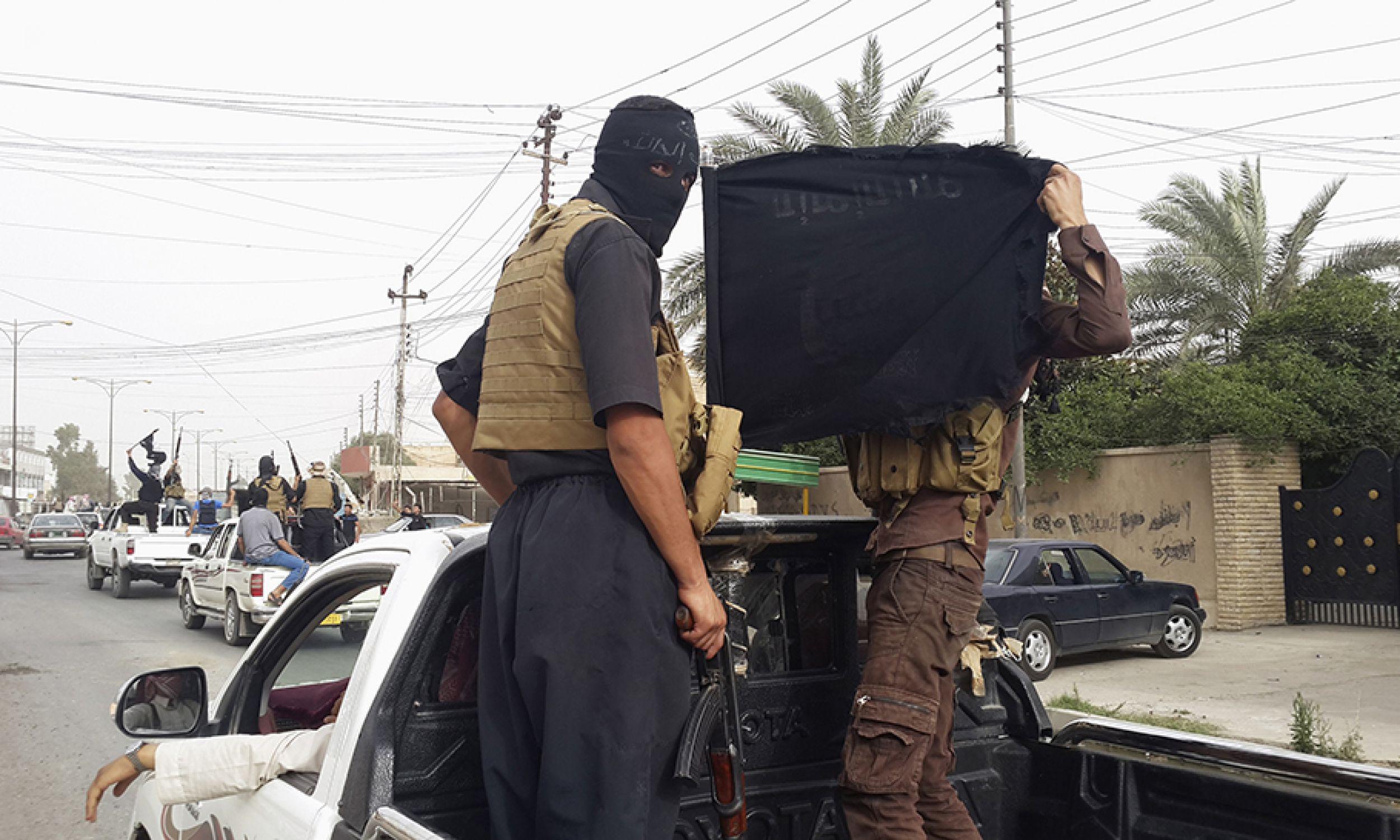 Bojownicy ISIS (fot. REUTERS/Stringer)