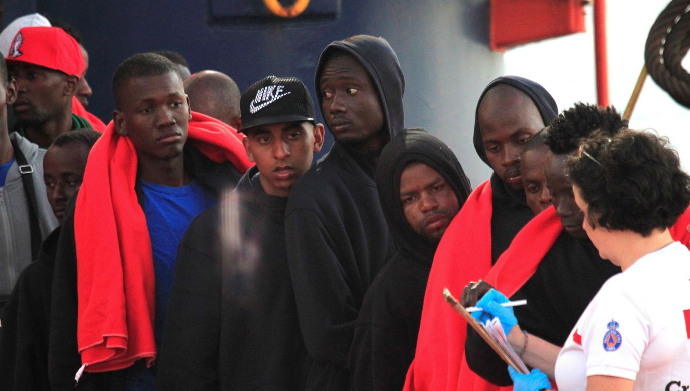Sub-Saharan people arrive in the port of Almeria, southern Spain, after being rescued on July 16, 2018. A total of 43 immigrants, on board a boat, were rescued in the Strait of Gibraltar. Photo: EPA/CARRASCO RAGEL