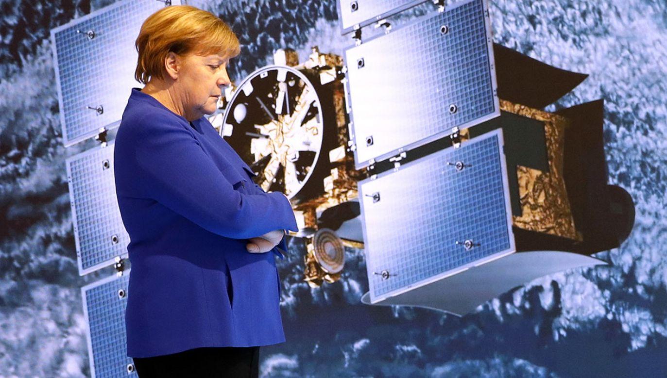 Liberalna polityka migracyjna Angeli Merkel osłabiła niemiecką chadecję (fot. PAP/EPA/FRANCK ROBICHON)
