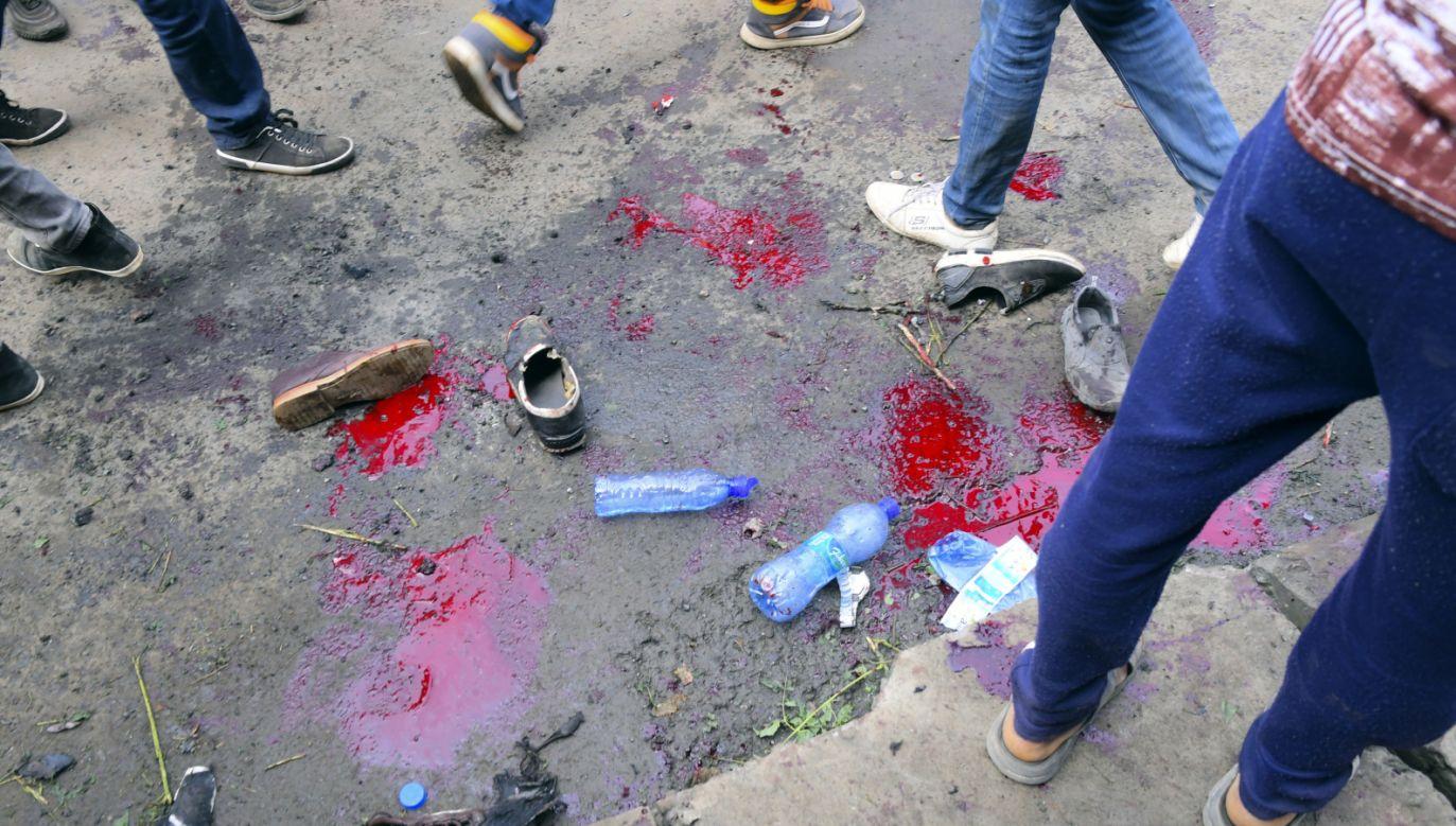 Zdaniem organizatorów wiecu wybuchł granat (fot. PAP/EPA/STR)