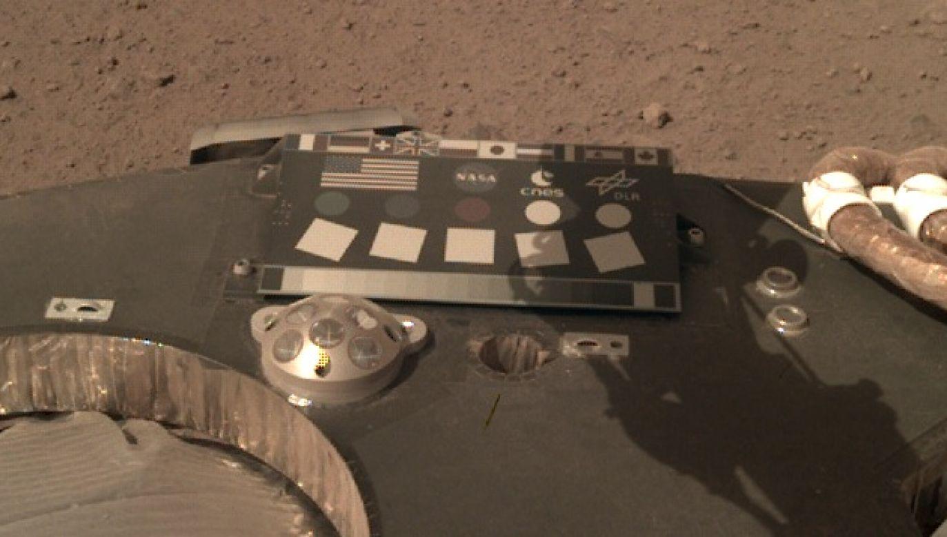 NASA's InSight Mars lander sent the image on Sunday. The Polish flag is visible between the British and Japanese ones, just above the NASA logo. Photo: NASA/JPL-Caltech