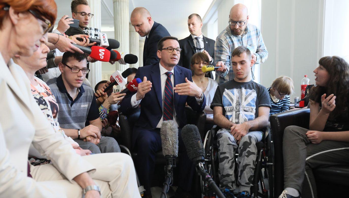 PM Morawiecki visits disabled people at Parliament. Photo: PAP/Leszek Szymański