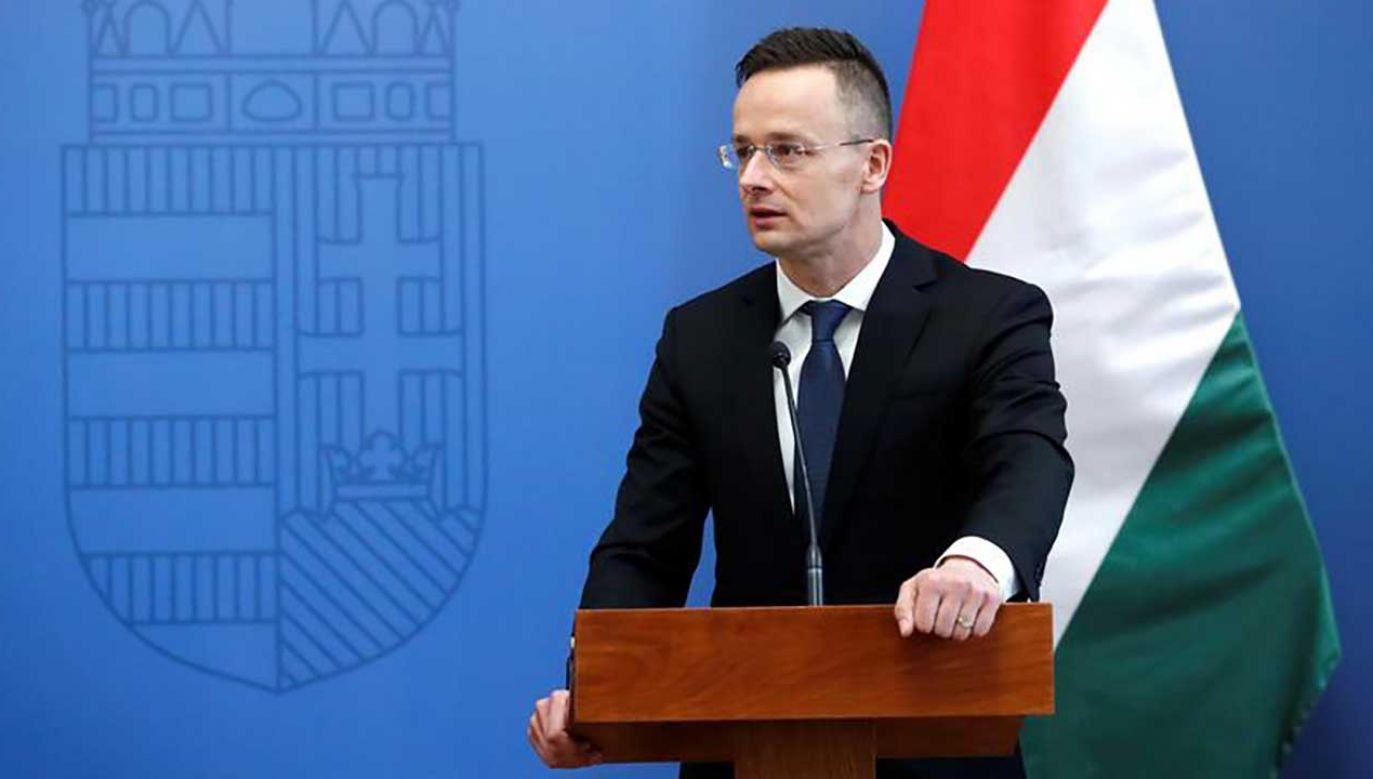 """""""My ze swojej strony także ogłosimy weto przy każdej próbie wprowadzenia ich przeciwko Warszawie"""" – powiedział Szijjarto (fot.  REUTERS/Bernadett Szabo)"""