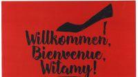 "Plakat koncertu ""Willkommen, Bienvenue, Witamy!"""